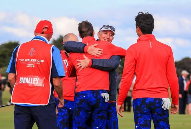 USA captain Nathanial Crosby celebrates with his players after they retained the Walker Cup (Peter Byrne/PA)