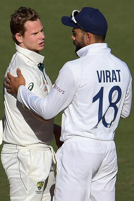 All over: Australia's Steve Smith talks with India's Virat Kohli