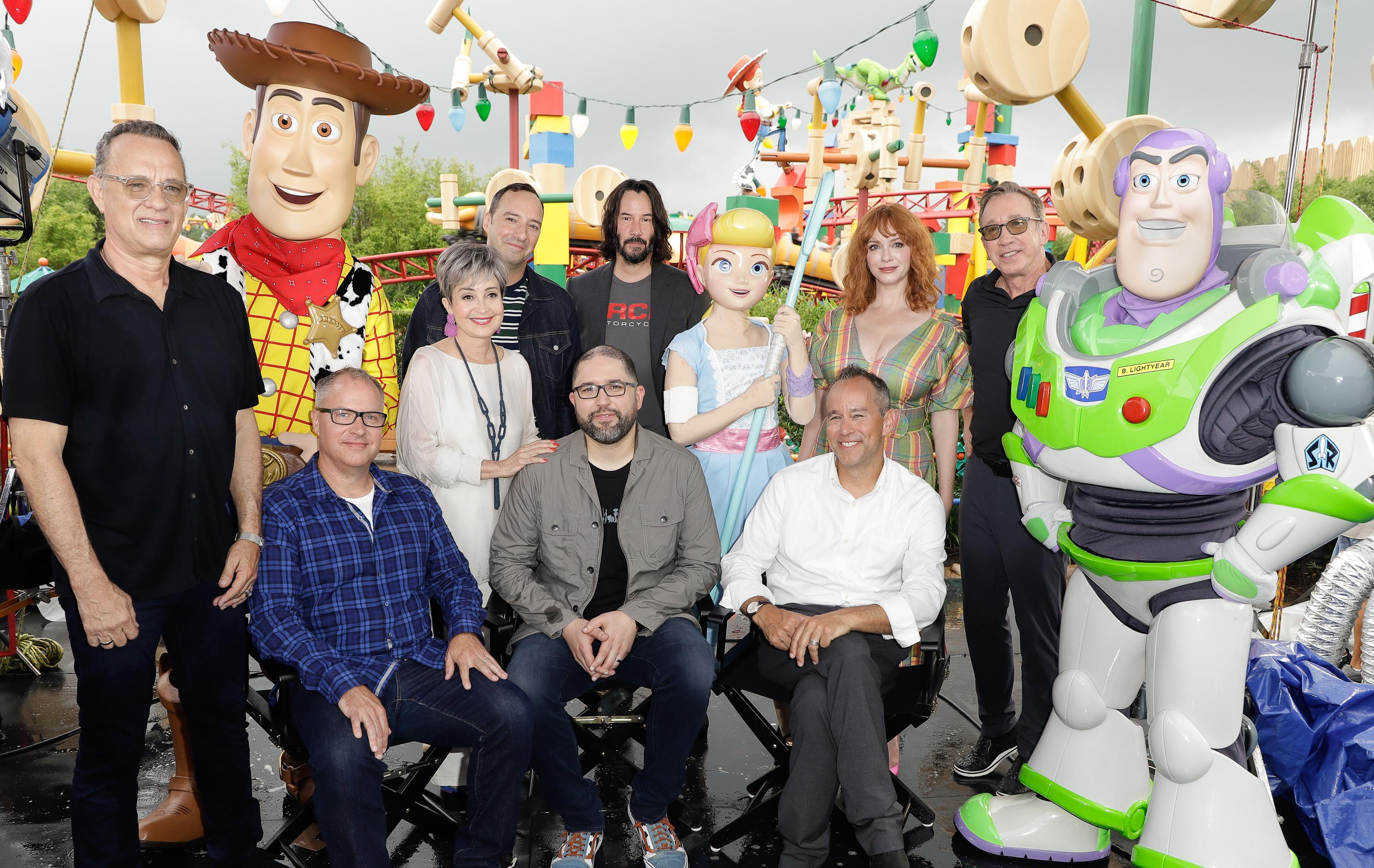 ORLANDO, FLORIDA - JUNE 08: Tom Hanks, Annie Potts, Tim Allen, Tony Hale, Christina Hendricks, Keanu Reeves, Mark Nielsen, Josh Cooley and Jonas Rivera visit Toy Story Land at Disney's Hollywood Studios on June 08, 2019 in Orlando, Florida. (Photo by John Parra/Getty Images for Disney)