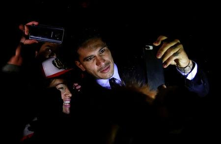 Captain of Peruvian national soccer team Guerrero poses for a selfie with fans in Zurich