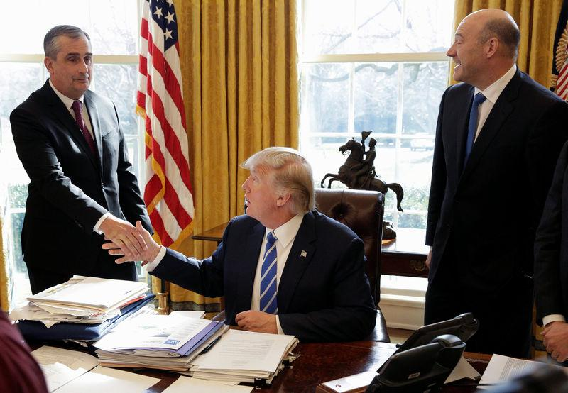 U.S. President Donald Trump shakes hands with Chief Executive Officer of Intel Brian Krzanich the Oval Office of the White House in Washington.