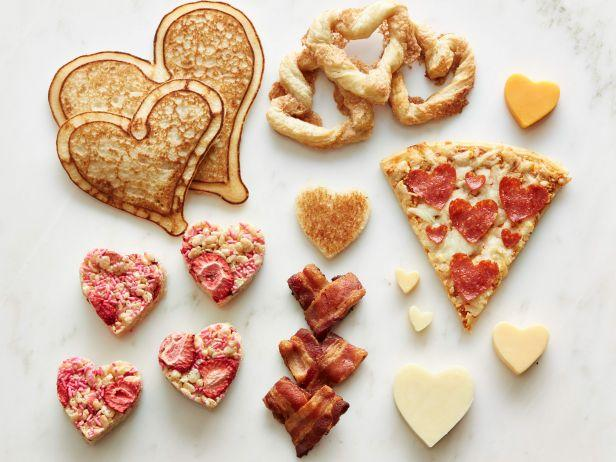 <p>If the way to someone's heart is through his or her stomach, these made-with-love foods cut right to the chase. Trust us, one look at these heart-shaped foods will set your valentine's own heart aflutter.</p>