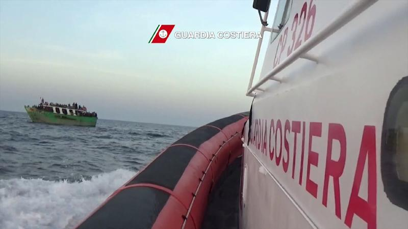 Video grab released by the Italian Coast Guard (Guardia Costiera) on May 6, 2015 shows migrants (L) on a boat before a rescue operation off the coast of Sicily as part of the Frontex-coordinated Operation Triton (AFP Photo/)