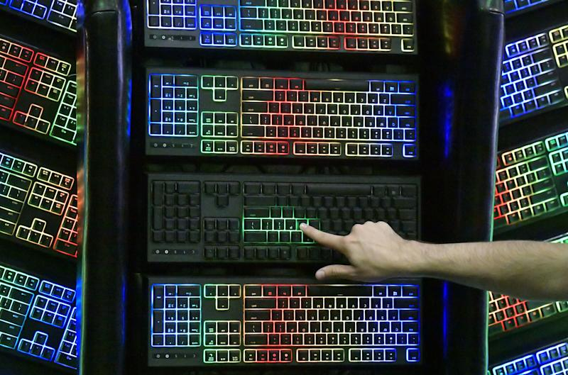 A volunteer touches an illuminated keyboard at the booth of Razer during a press day at the IFA, the world's leading trade show for consumer electronics and home appliances, in Berlin on September 4, 2019. Photo: TOBIAS SCHWARZ/AFP via Getty Images