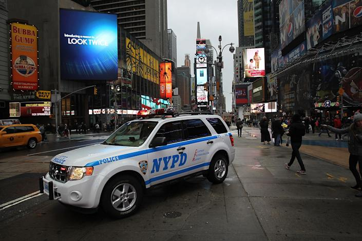 NEW YORK, NY - OCTOBER 29: A police car sits in Times Square as Hurricane Sandy begins to affect the area on October 29, 2012 in New York City. The storm, which threatens 50 million people in the eastern third of the U.S., is expected to bring days of rain, high winds and possibly heavy snow. New York Governor Andrew Cuomo announced the closure of all New York City will bus, subway and commuter rail service as of Sunday evening. (Photo by Spencer Platt/Getty Images)
