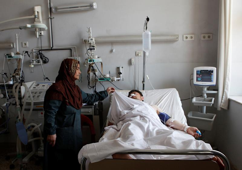 Afghan Officials Say 100 Casualties in Attack on Afghanistan Military Compound
