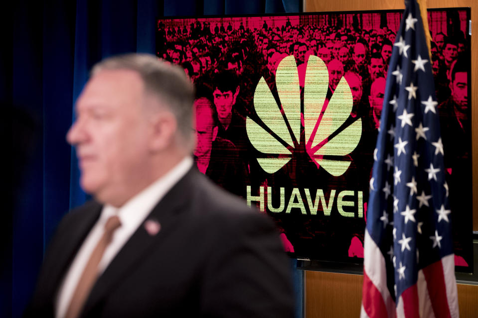 """A monitor displays the logo for """"Huawei"""" behind Secretary of State Mike Pompeo as he speaks during a news conference at the State Department in Washington, Wednesday, July 15, 2020. (AP Photo/Andrew Harnik, Pool)"""