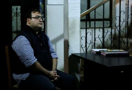 Former governor of Mexican state Veracruz Javier Duarte sits at a police station after he was detained in a hotel in Panajachel