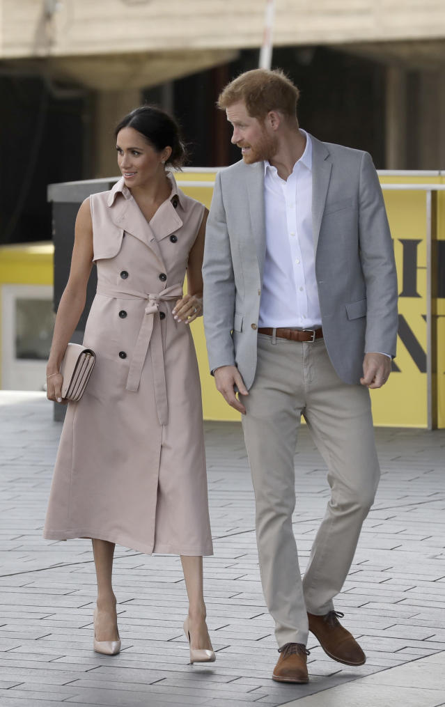 Meghan and Prince Harry visited the Nelson Mandela exhibit in honor of the anti-apartheid leader's centenary. (Photo: AP Photo/Matt Dunham)