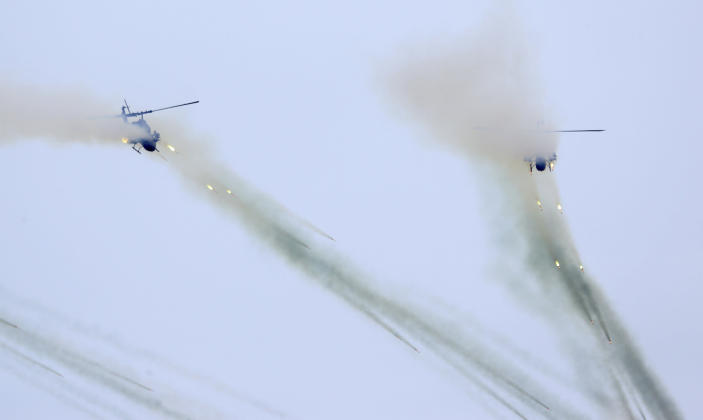 Taiwan's AH-1W attack helicopters launch Hellfire missiles during the 36th Han Kung military exercises in Taichung City, central Taiwan, Thursday, July 16, 2020. (AP Photo/Chiang Ying-ying)