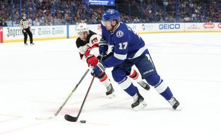 Nov 25, 2018; Tampa, FL, USA; Tampa Bay Lightning left wing Alex Killorn (17) skates with he puck as New Jersey Devils center Travis Zajac (19) defends during the first period at Amalie Arena. Mandatory Credit: Kim Klement-USA TODAY Sports
