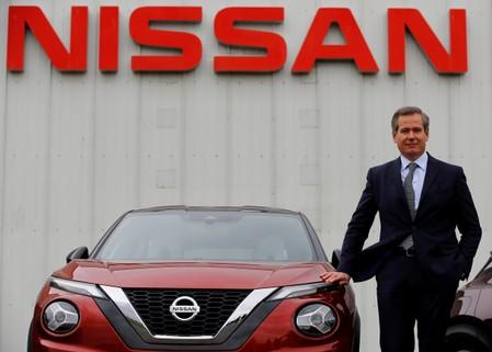 Nissan's European Chairman Gianluca de Ficchy poses for a photograph next to a new Juke car outside the company's car plant in Sunderland Britain