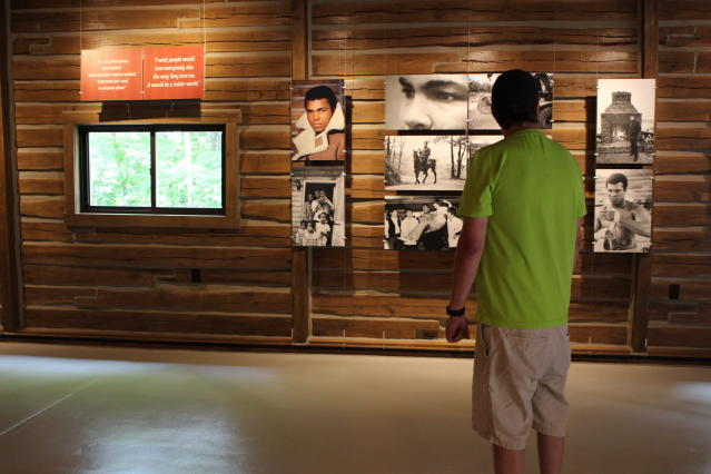 Ty Benner looks at a display in the gym at Fighters Heaven, Muhammad Alis training camp in Deer Lake, Pa., Saturday June 8, 2019. The newly renovated camp is open to the public on weekends. (AP Photo/Michael Rubinkam)