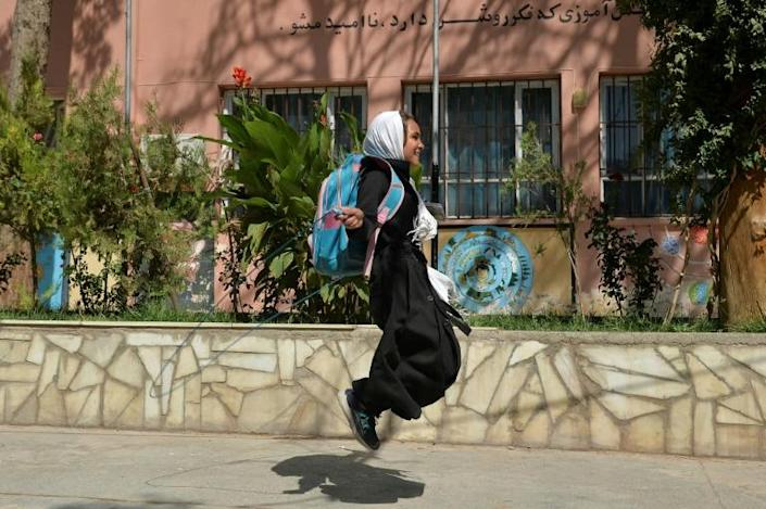 A young girl skips on a rope outside her primary school in Herat (AFP/Hoshang Hashimi)