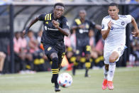 Columbus Crew's Derrick Etienne left, and Chicago Fire's Miguel Angel Navarro chase the ball during the first half of an MLS soccer match Saturday, June 19, 2021, in Columbus, Ohio. (AP Photo/Jay LaPrete)