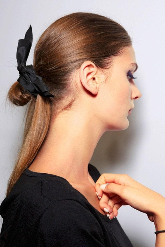 A quick DIY hack worth your time: Cut a small piece off a gauzy scarf and tie it onto a basic hair tie.