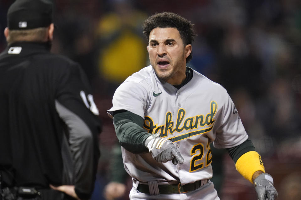 Oakland Athletics' Ramon Laureano argues with home plate umpire Ryan Wills after striking out in the third inning of a baseball game against the Boston Red Sox, Wednesday, May 12, 2021, in Boston. (AP Photo/Charles Krupa)