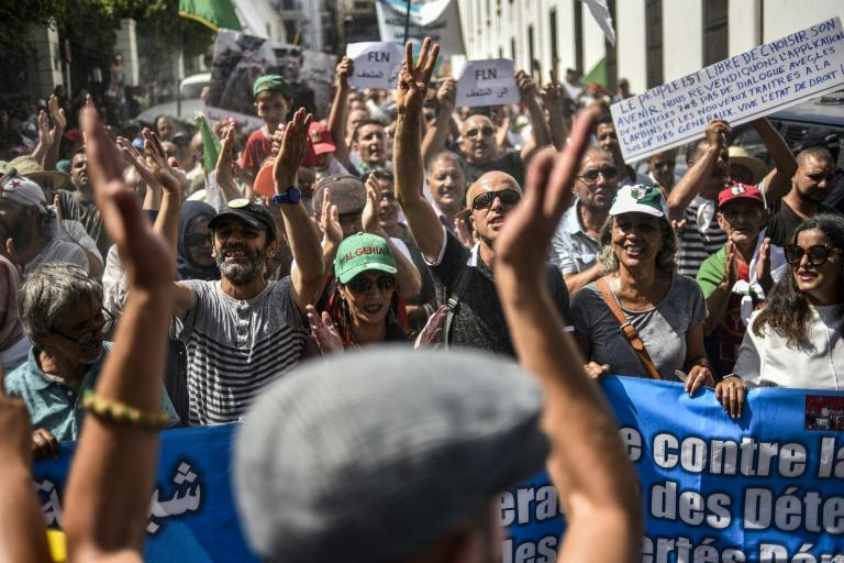 Protesters called for the resignation of the army chief and other political figures in Algeria on Friday, as demonstrations moved into a seventh month (AFP Photo/RYAD KRAMDI)