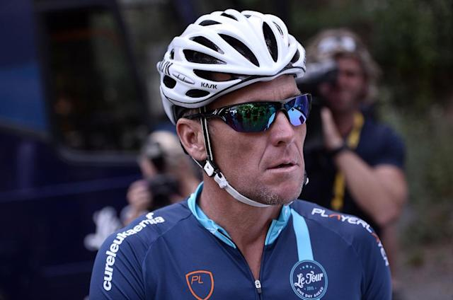 Lance Armstrong looks on upon his arrival in Rodez, southwest France, after riding a stage of The Tour De France for a leukaemia charity