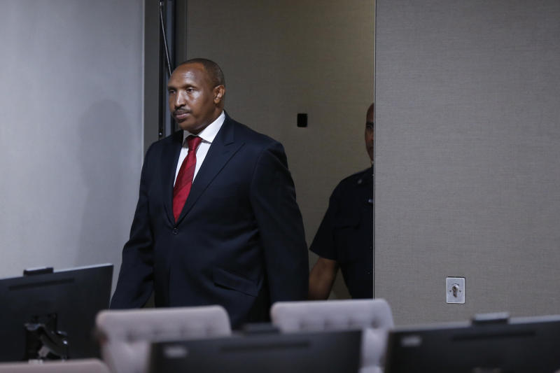 Congolese militia commander Bosco Ntaganda enters the courtroom of the ICC (International Criminal Court) during his trial at the Hague in the Netherlands, Monday July 8, 2019. The ICC is expected to pass judgement Monday on Ntaganda, accused of overseeing the slaughter of civilians by his soldiers in the Democratic Republic of Congo in 2002 and 2003. (Eva Plevier/Pool via AP)