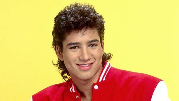 A.C. Slater, played by Mario Lopez, was one character from <em>Saved By the Bell</em> whose shirtless posters wallpapered childhood rooms. (Photo: InStyle)