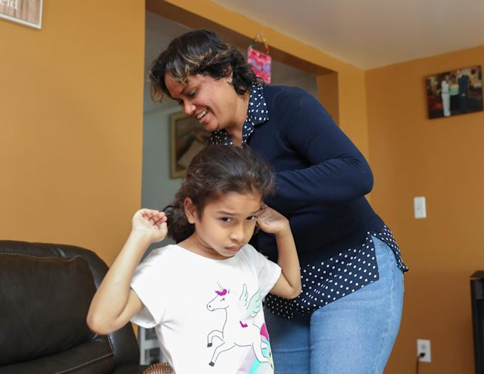 Shelly Guzman has been taking care of all of her 7-year-old daughter Faith's needs in their Washingtonville, N.Y., home since the Jesse Kaplan School in West Nyack closed due to COVID-19 pandemic.