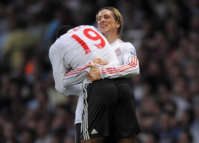 What a player: Fernando Torres gives Ryan Babel a hug