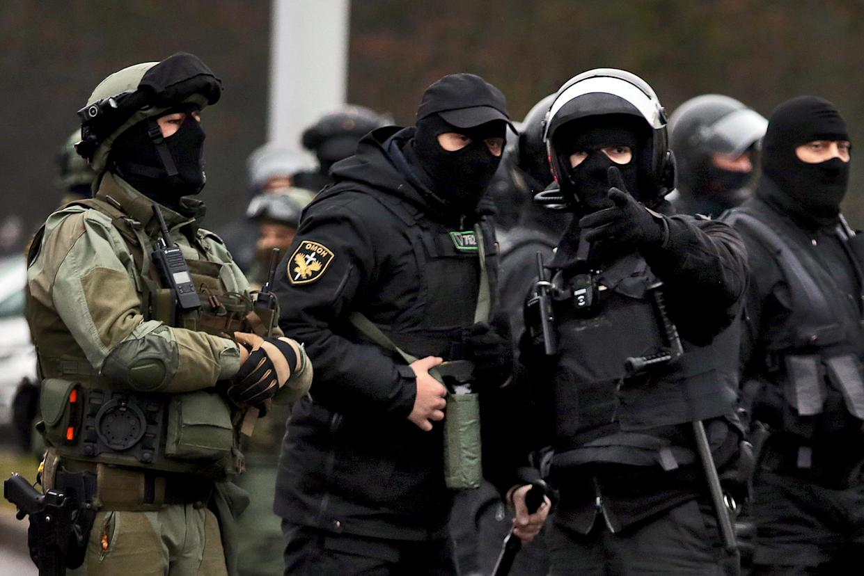 Law enforcement officers patrol a street as opposition supporters rally to protest against police violence and Belarus presidential election results in Minsk on November 22, 2020. (Stringer/AFP via Getty Images)