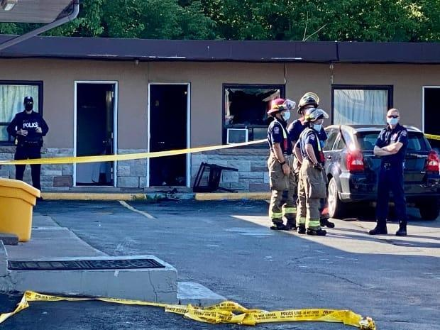Toronto Police Services and Toronto Fire are investigating a fatal fire in a motel room in Scarborough on Monday morning, after a man in his 40s died of his injuries. (Martin Trainor/CBC - image credit)