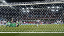 Tottenham's Harry Kane, centre, scores his team's second goal from the penalty spot during the English Premier League soccer match between Aston Villa and Tottenham Hotspur at Villa Park in Birmingham, England, Sunday, March 21, 2021. (AP Photo/Tim Keeton,Pool)
