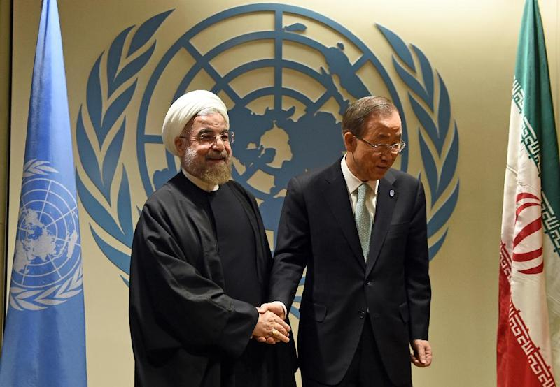 UN Secretary-General Ban Ki-moon (R) greets Iranian President Hassan Rouhani before a meeting at the United Nations in New York on September 23, 2014 (AFP Photo/Jewel Samad)