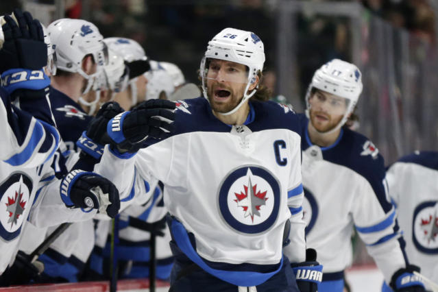 Winnipeg Jets right wing Blake Wheeler celebrates after scoring a goal on the Minnesota Wild in the first period of an NHL hockey game Saturday, Dec. 21, 2019, in St. Paul, Minn. (AP Photo/Andy Clayton-King)