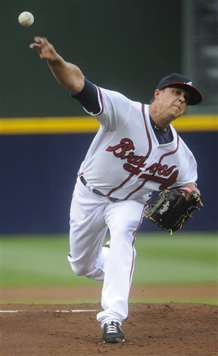 Atlanta Braves pitcher Kris Medlen delivers in the first inning of a baseball game against the Kansas City Royals, Tuesday, April 16, 2013, in Atlanta. (AP Photo/John Amis)