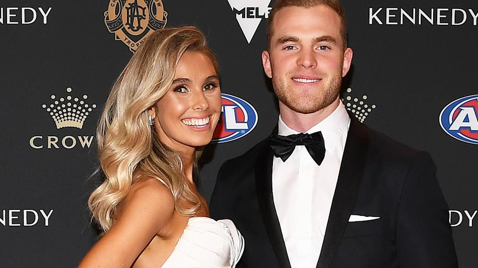 Tom Mitchell and his partner Hannah Davis pictured at the 2019 Brownlow Medal. (Photo by Quinn Rooney/Getty Images)