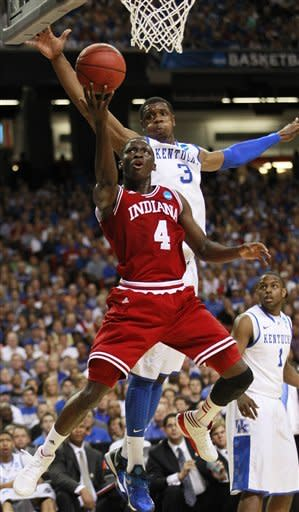 Indiana's Victor Oladipo (4) and Kentucky's Terrence Jones (3) vie for a lose ball during the first half of an NCAA tournament South Regional semifinal college basketball game Friday, March 23, 2012, in Atlanta. (AP Photo/John Bazemore)