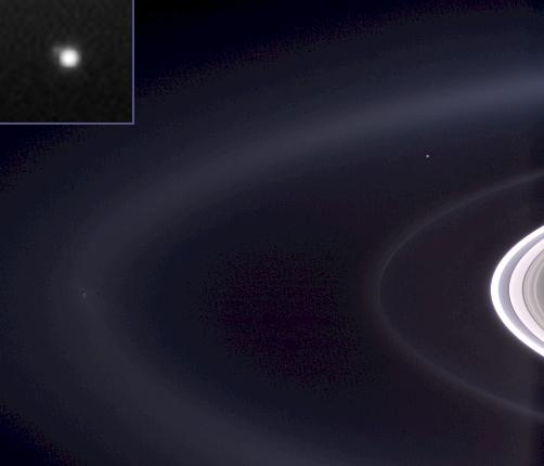 In this photo by NASA's Cassini orbiter around Saturn, the planet Earth is visible as the small bright dot.
