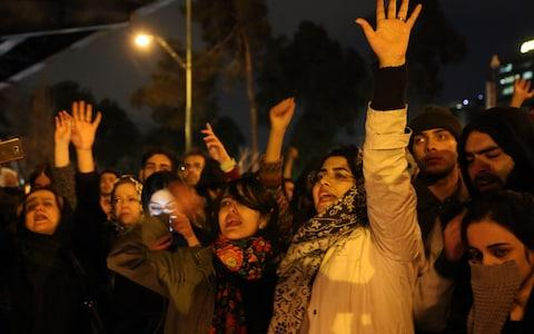 Iranians shout slogans against the government after a vigil held for the victims of the airplane of Ukrainian International Airlines - Credit: Anadolu