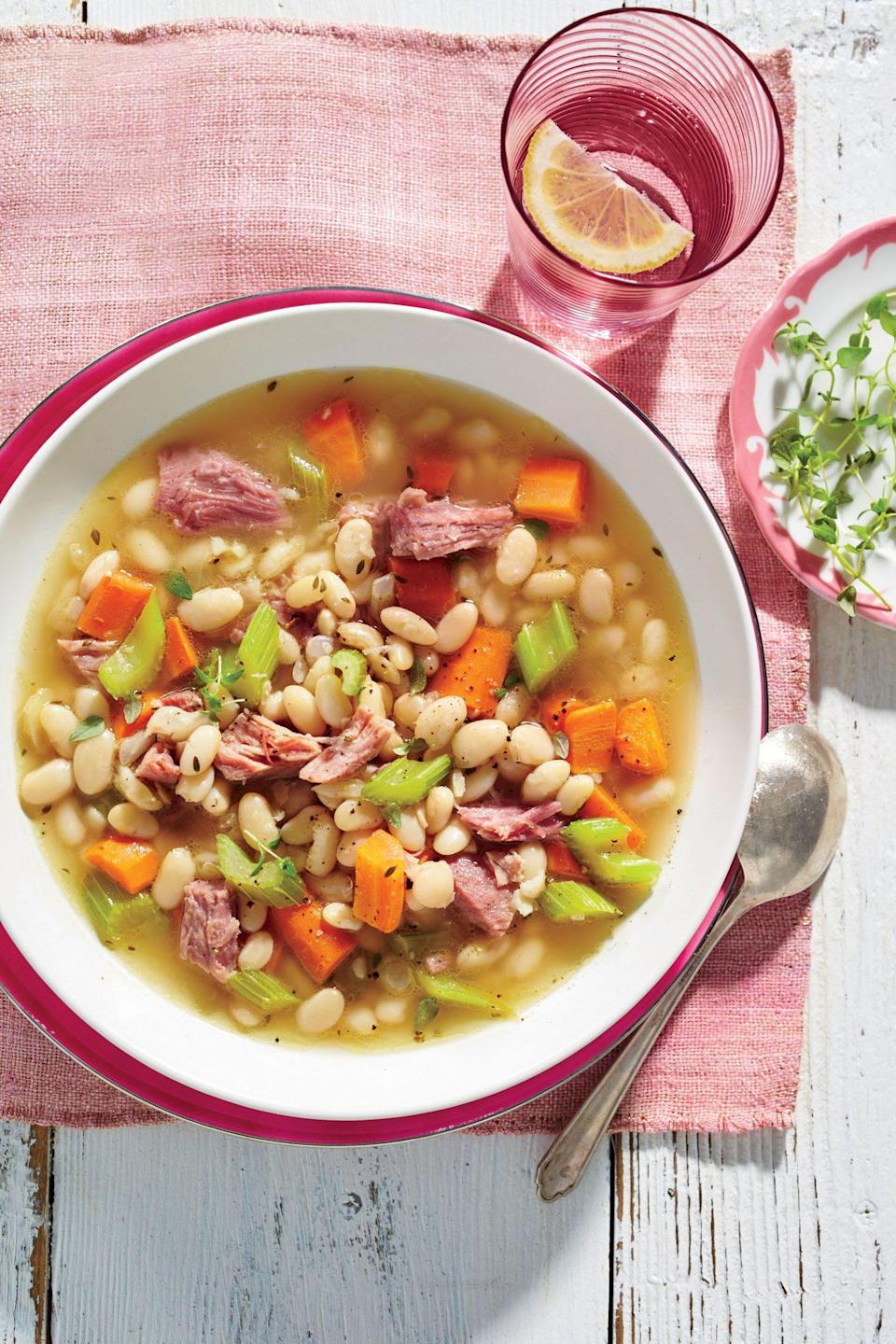 """<p><strong>Recipe: <a href=""""https://www.southernliving.com/recipes/ham-and-bean-soup-recipe"""" rel=""""nofollow noopener"""" target=""""_blank"""" data-ylk=""""slk:Ham-and-Bean Soup"""" class=""""link rapid-noclick-resp"""">Ham-and-Bean Soup</a></strong></p> <p>For any occasion that ham is on the menu, make sure you save the meaty bone so you can enjoy this bean soup a few days later. In addition to the bone, you'll just add dried white beans, chopped carrots, celery, onions, garlic, chicken stock, and fresh thyme to your slow cooker and let it simmer for 5 to 6 hours. </p>"""