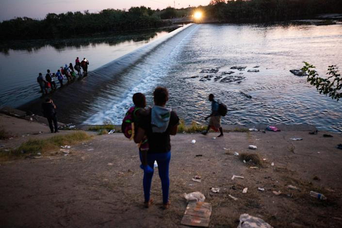Haitian migrants prepare to cross the Rio Grande into Del Rio, Texas from Ciudad Acuna on September 18, 2021. Thousands of migrants have arrived in the border city and have camped underneath the Del Rio International Bridge on the U.S. side of the border.