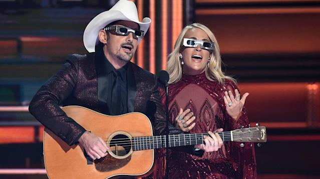 Carrie Underwood and Brad Paisley couldn't resist poking fun at President Donald Trump at Wednesday night's Country Music Awards in Nashville, Tennessee.