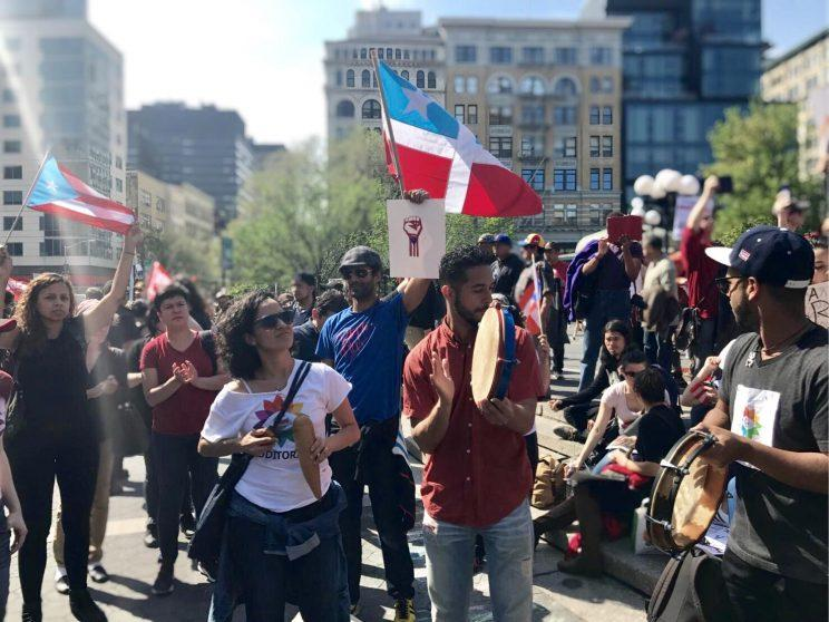Members of New York's Puerto Rican community play instruments while rallying in solidarity with protesters in Puerto Rico at a May Day event in New York City Monday, May 1, 2017. (Photo: Caitlin Dickson/Yahoo News)