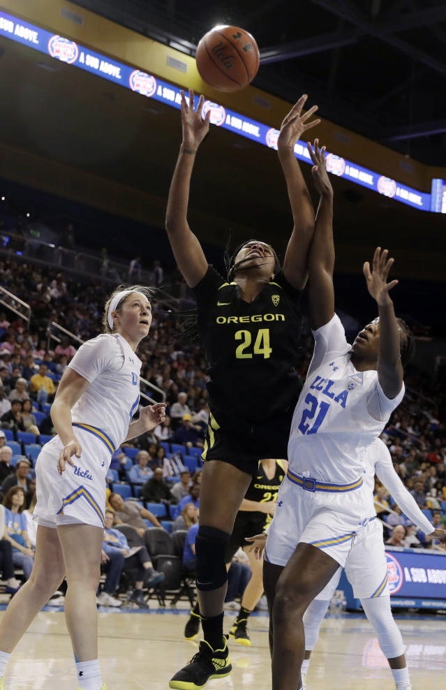 Oregon forward Ruthy Hebard (24) shoots as UCLA forward Michaela Onyenwere (21) defends during the first half of an NCAA college basketball game Sunday, Jan. 13, 2019, in Los Angeles. (AP Photo/Marcio Jose Sanchez)