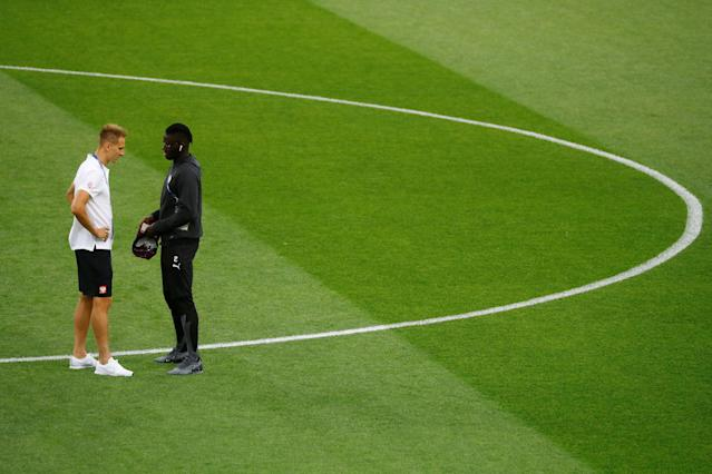 Soccer Football - World Cup - Group H - Poland vs Senegal - Spartak Stadium, Moscow, Russia - June 19, 2018 Poland's Lukasz Teodorczyk and Senegal's Kara Mbodji on the pitch before the match REUTERS/Kai Pfaffenbach