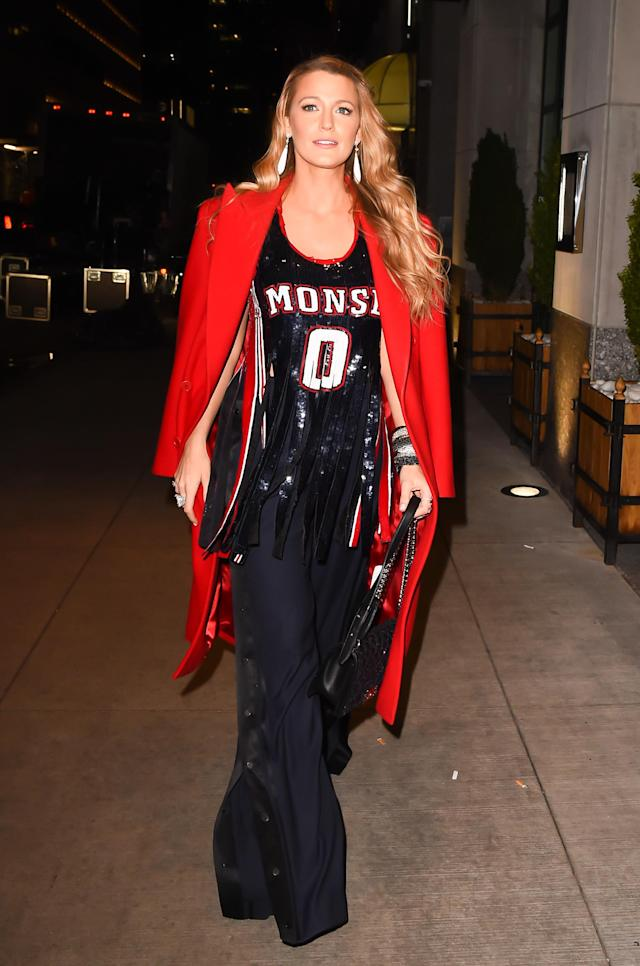 <p>For the premiere of her new film, the actress waltzed in wearing a shredded basketball top and flared navy trousers by Monse. (Photo: Getty Images) </p>