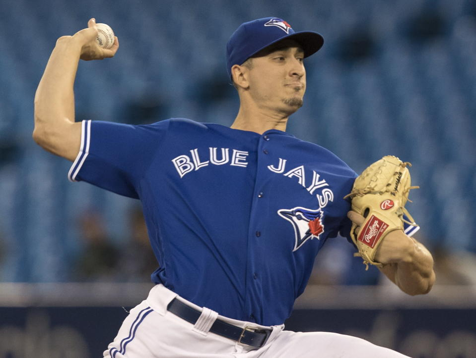 Toronto Blue Jays starting pitcher Jacob Waguespack throws against the Baltimore Orioles during the first inning of a baseball game, Wednesday, Sept. 25, 2019 in Toronto, (Fred Thornhill/The Canadian Press via AP)