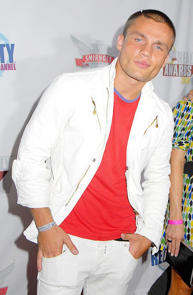 """""""America's Most Smartest Model"""" runner-up Andre Birleanu struck a pose in a zipper-adorned jacket, matching white pants (after Labor Day!), and a smirk. Barry King/<a href=""""http://www.wireimage.com"""" target=""""new"""">WireImage.com</a> - September 24, 2008"""