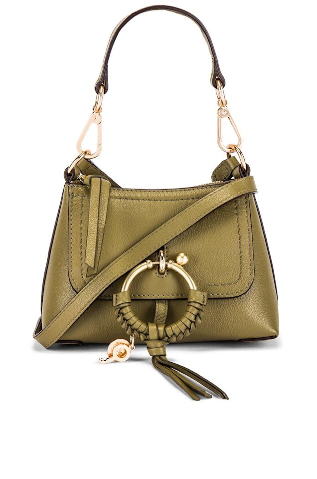 "<p><a href=""https://www.popsugar.com/buy/See-Chlo%C3%A9-Joan-Mini-Leather-Crossbody-Safari-Khaki-502118?p_name=See%20By%20Chlo%C3%A9%20Joan%20Mini%20Leather%20Crossbody%20in%20Safari%20Khaki&retailer=revolve.com&pid=502118&price=295&evar1=fab%3Aus&evar9=46766147&evar98=https%3A%2F%2Fwww.popsugar.com%2Fphoto-gallery%2F46766147%2Fimage%2F46766177%2FGreen-Shoulder-Bag-at-Revolve&prop13=api&pdata=1"" rel=""nofollow"" data-shoppable-link=""1"" target=""_blank"" class=""ga-track"" data-ga-category=""Related"" data-ga-label=""https://www.revolve.com/see-by-chloe-joan-mini-leather-crossbody/dp/SEEB-WY327/"" data-ga-action=""In-Line Links"">See By Chloé Joan Mini Leather Crossbody in Safari Khaki</a> ($295)</p>"