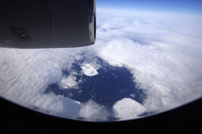 An aerial view looking down near the Alexandra Land island of the Franz Josef Land archipelago, Russia, Monday, May 17, 2021. Once a desolate home mostly to polar bears, Russia's northernmost military outpost is bristling with missiles and radar and its extended runway can handle all types of aircraft, including nuclear-capable strategic bombers, projecting Moscow's power and influence across the Arctic amid intensifying international competition for the region's vast resources. (AP Photo/Alexander Zemlianichenko)