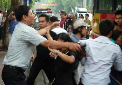 Plainclothed police officers arrest and push protesters into a bus during a brief anti-China rally in the centre of Hanoi on August 21. At least eight political activists have been arrested on subversion charges in Vietnam, their legal adviser said, in a crackdown that began after the prime minister was re-appointed