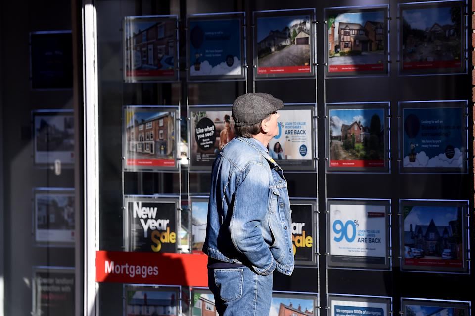 MACCLESFIELD-ENGLAND - FEBRUARY 01:  A man is seen looking at houses for sale at an estate agents on February 01, 2021 in Macclesfield , England . (Photo by Nathan Stirk/Getty Images)